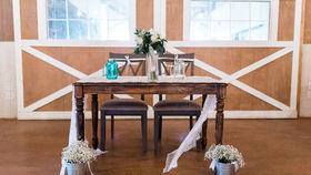 Image of a Dark Wood Sweetheart Table