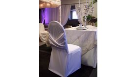 Image of a White Swag Chair Cover