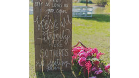 Image of a We're All Family Sign