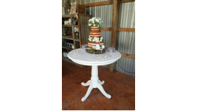 Image of a Large White Cake Table