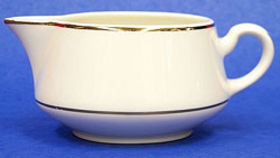 Image of a Creamer - cream/gold