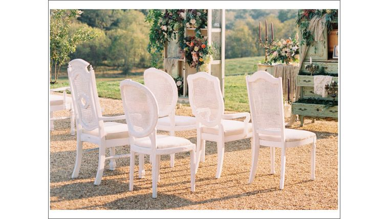 Picture of a White Distressed Cane Back Chairs