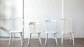 Image of a Mismatched White Chairs