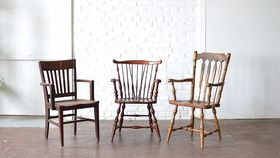 Image of a Mismatched Wooden Armchairs