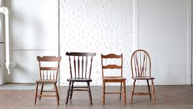 Image of a Mismatched Wooden Chairs