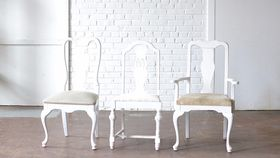 Image of a White Upholstered Dining Chairs