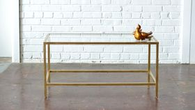 Image of a Gold & Glass Coffee Table