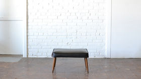 Image of a Mid-Century Black Ottoman