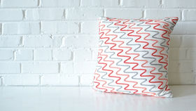 Image of a Peach & Gray Pillow