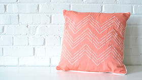 Image of a Coral Chevron Pillow