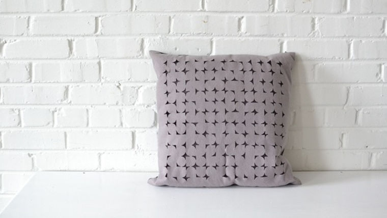 Picture of a Geometric Cut Out Square Pillow