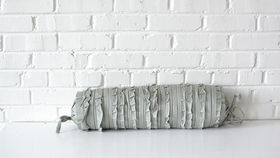 Image of a Gray Bolster Pillow