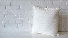Image of a White Ruffle Pillow