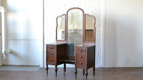 Image of a Mirrored Wood Vanity