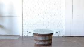 Image of a Barrel Coffee Table with Glass Top