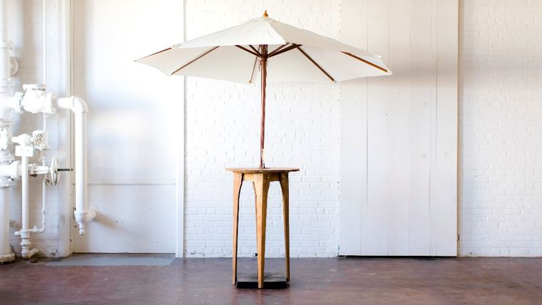 Picture of a Aperture Cocktail Table with Umbrella