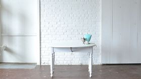 Image of a Round White Drop Leaf Table