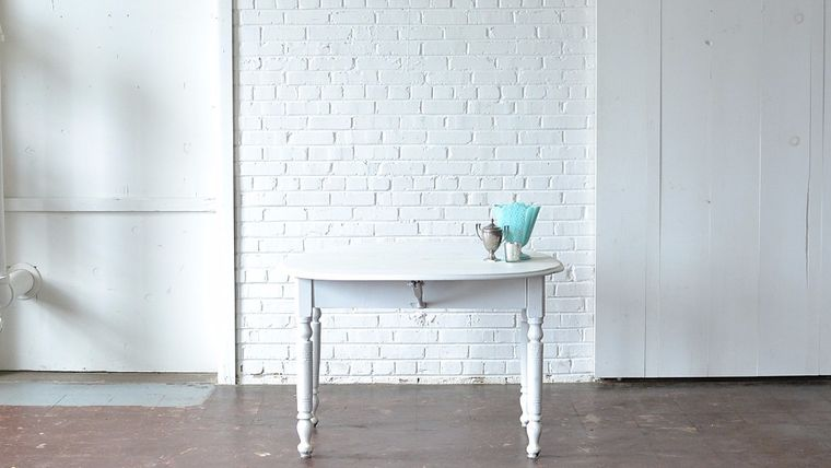 Picture of a Round White Drop Leaf Table