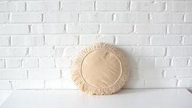 Image of a Round Cream Pillow