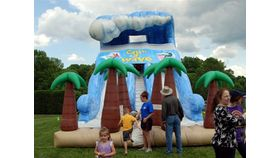 Image of a Catch a Wave Double Lane Inflatable Slide