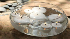 Image of a Candles: Vase w/ Floating Candles and Pebbles