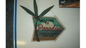 "Image of a ""Welcome to Paradise"" Beach Sign"