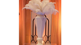 Image of a Centerpiece: Geo Octagon Urn w/ White Feathers
