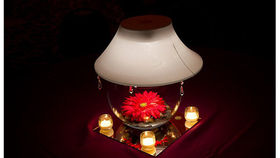 Image of a Fish Bowl with White Lampshade and Red Gerber Daisy