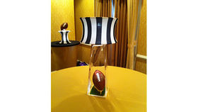 Image of a Centerpiece: Lamp Light Striped Shade & Football