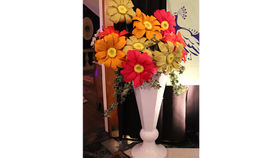 Image of a Centerpiece: Geo Octagon Urn with Gerber Daisies