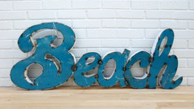 Image of a Vintage Beach Drum Sign