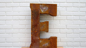 Image of a Reclaimed Tin Letter, E