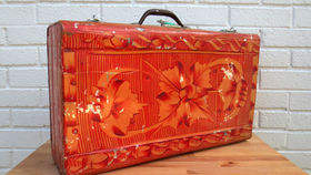 Image of a Vintage Luggage, Red Polynesian Tin