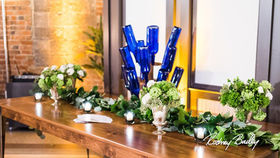 Image of a Centerpiece: Bottle Drying Rack w/ Cobalt Bottles