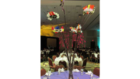 Image of a Centerpiece: Tall Reeds w/ Feather Masks