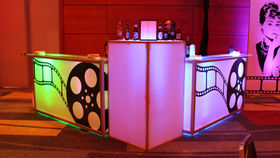 Image of a Lit Bar with Hollywood Film Reels