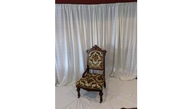 Image of a Brown and Gold Accent Chair
