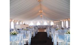 Image of a 40 x 100 Tent Ceiling Draping and Perimeter Lighting
