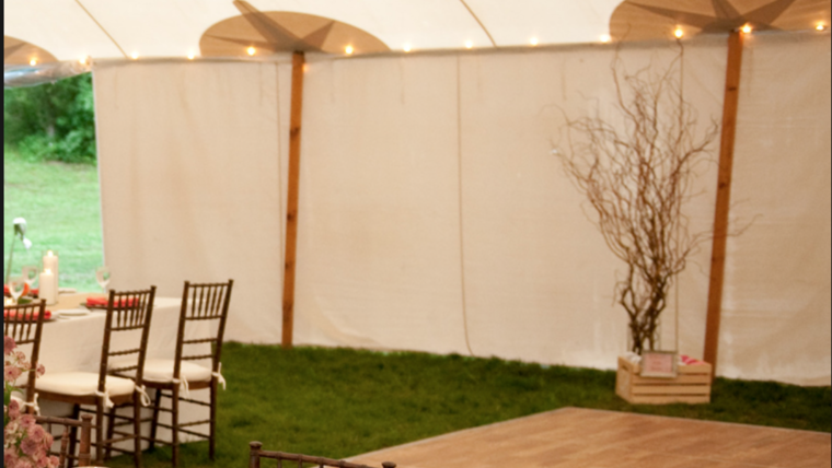 Picture of a 20ft Sperry Tent Solid Sidewalls