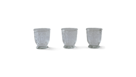 Image of a ANTIQUE CLEAR TEALIGHT HOLDERS