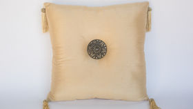 Image of a BEIGE PEADED PILLOW