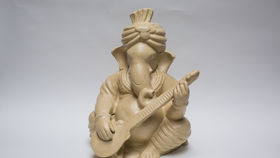 Image of a CREAM GANESH - (GUITAR) - MEDIUM
