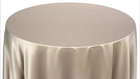 """Image of a 132"""" Round Satin Candlelight Glow Tablecloth"""