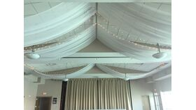 Image of a Boca Ciega Ballroom Flat Waves Ceiling Installation with Starlights