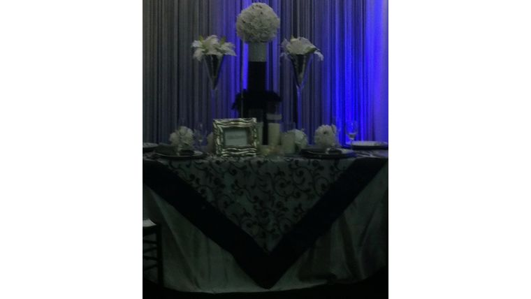 """Picture of a 54""""x54"""" Black Organza/Satin Scroll Table Topper"""
