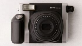 Image of a Black Wide Instant Camera