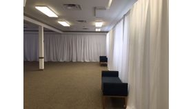 Image of a 12' X 30' Pipe & Drape - White Voile