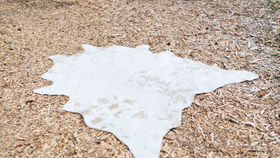 Image of a Brooklyn Gold & Cream Faux Cowhide Rug