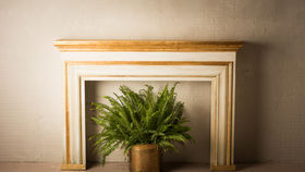 Image of a GILDED FIREPLACE MANTLE