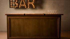Image of a 8' FAUX WOOD GRAIN W/ COPPER TOP BAR